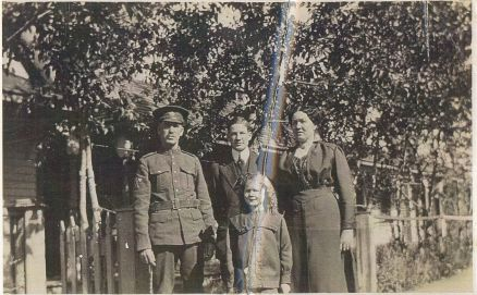 William prepares to go to war by taking a picture with is wife Linda and children Roy and Myrell
